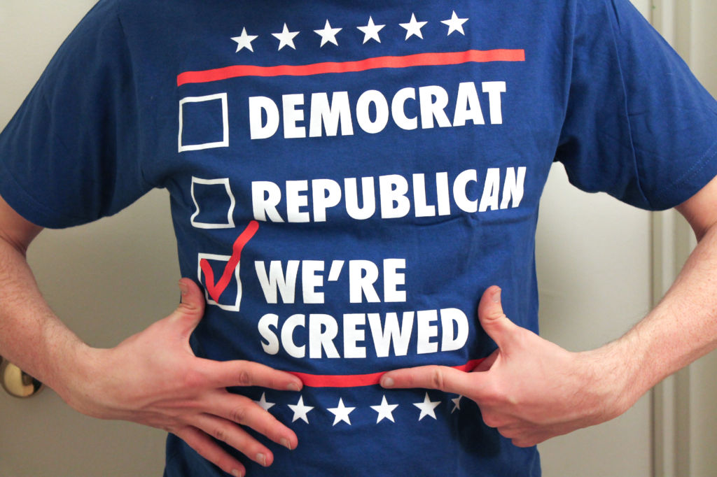 "man wearing shirt that says ""we're screwed"""