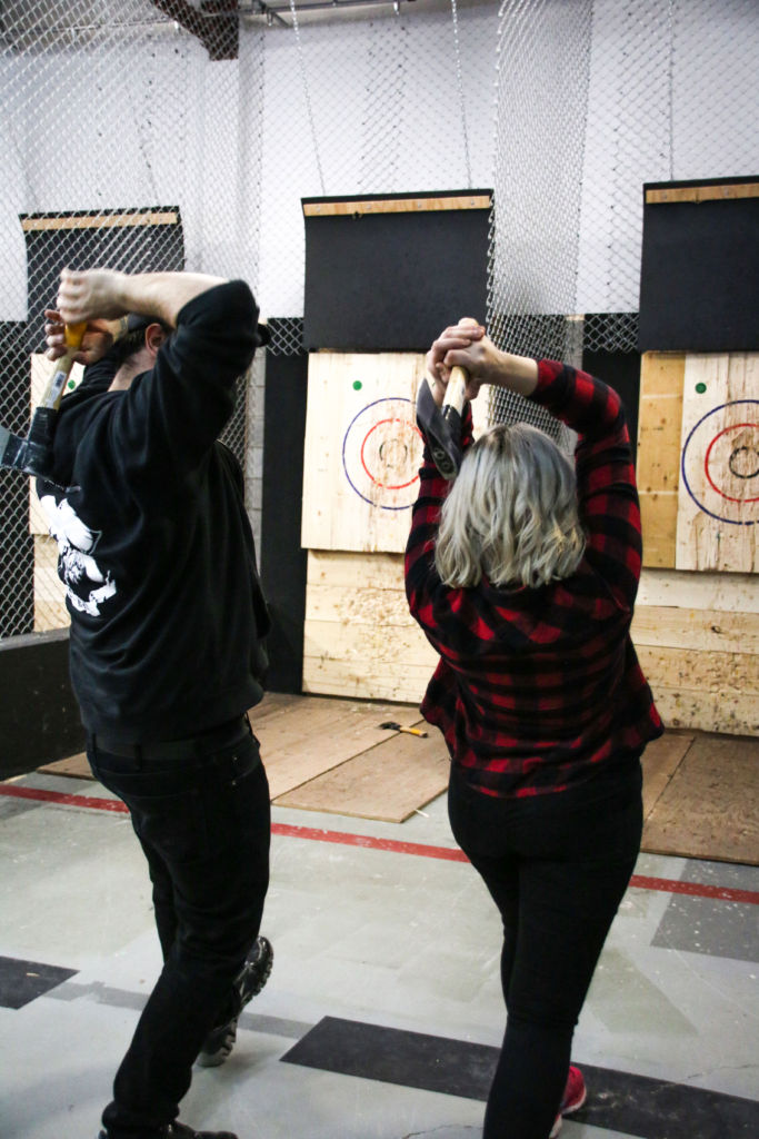 Girl trying axe throwing