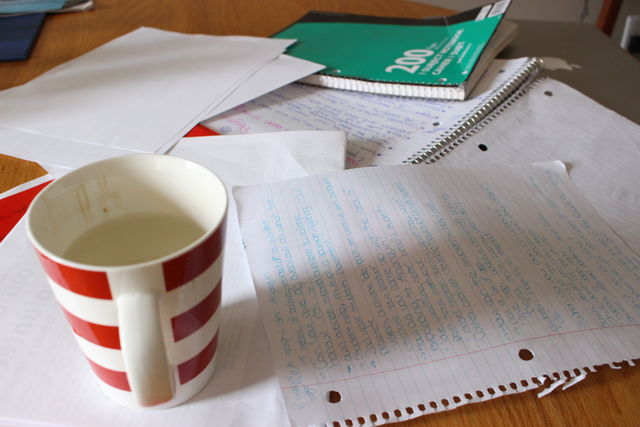 Photo of schoolwork and coffee