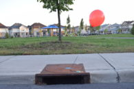 Photo of balloon attached to sewer grate