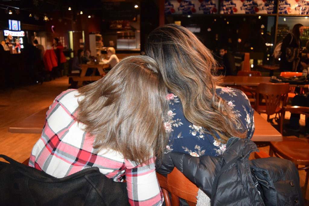 Photo of two women cuddling