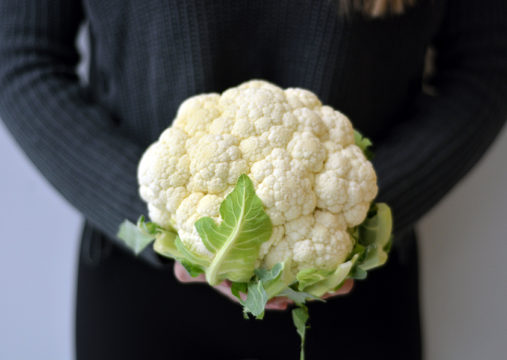 Photo of someone holding a caulifower