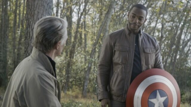 Sam Wilson being given Captain America's shield by Steve Rogers in Avengers: Endgame